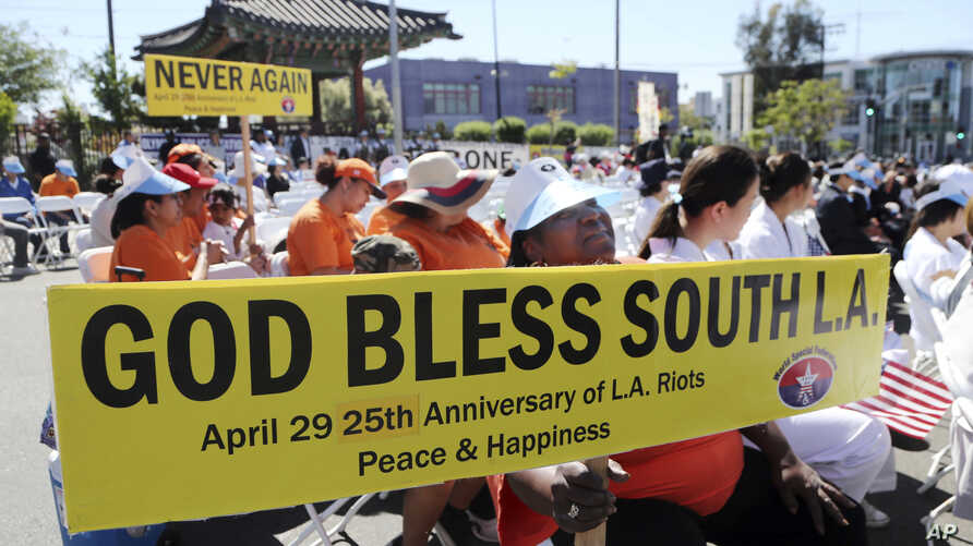 People take part in a rally and peace parade in Los Angeles' Koreatown, sponsored by the Korean-American community with participation by many ethnic groups, on the 25th anniversary of riots that erupted after the 1992 acquittal of four white police o