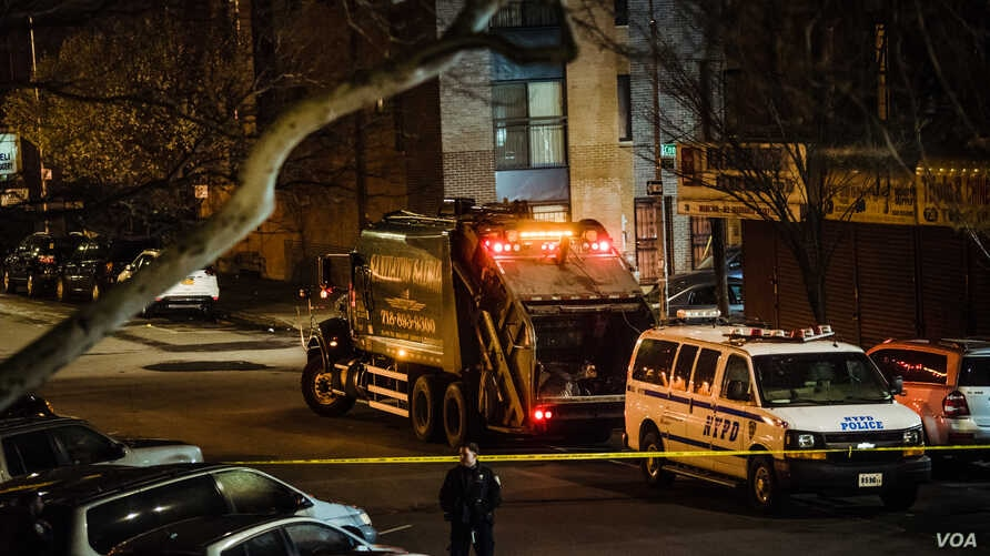 A Sanitation Salvage truck behind police tape at 152nd Street and Jackson Ave. in Woodstock, Bronx.