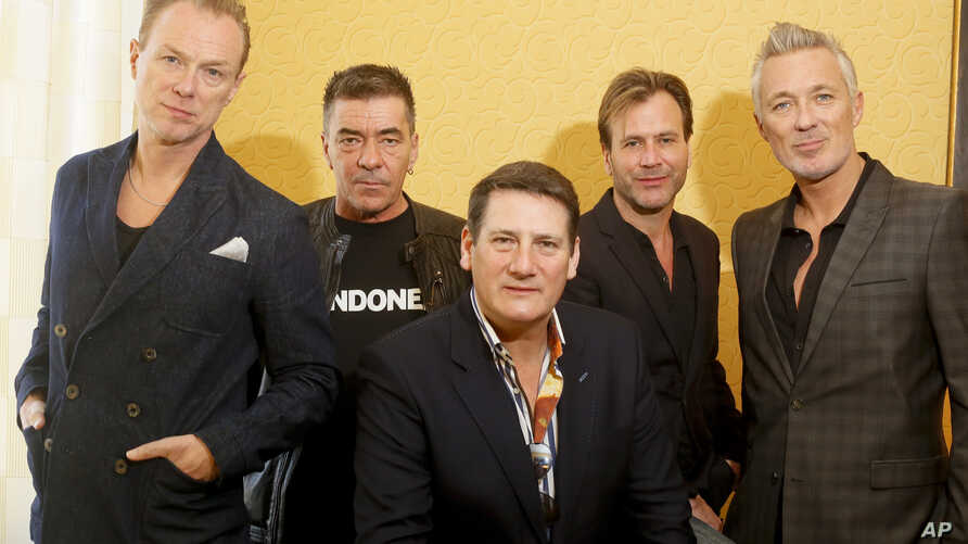 Spandau Ballet members Gary Kemp, John Keeble, Tony Hadley, Steve Norman and Martin Kemp, from left, pose for a photograph during the SXSW Music Festival in Austin, Texas, March 13, 2014.