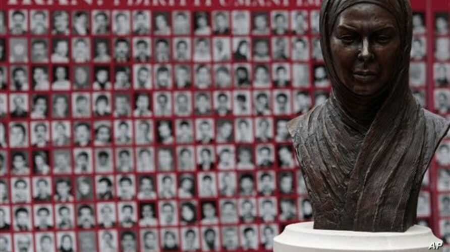 Bust of Neda Agha Soltan, a student killed during Tehran's 2009 election protests, before pictures of what rights advocates say are victims of Iranian human rights violators, Rome, Feb. 11, 2010.