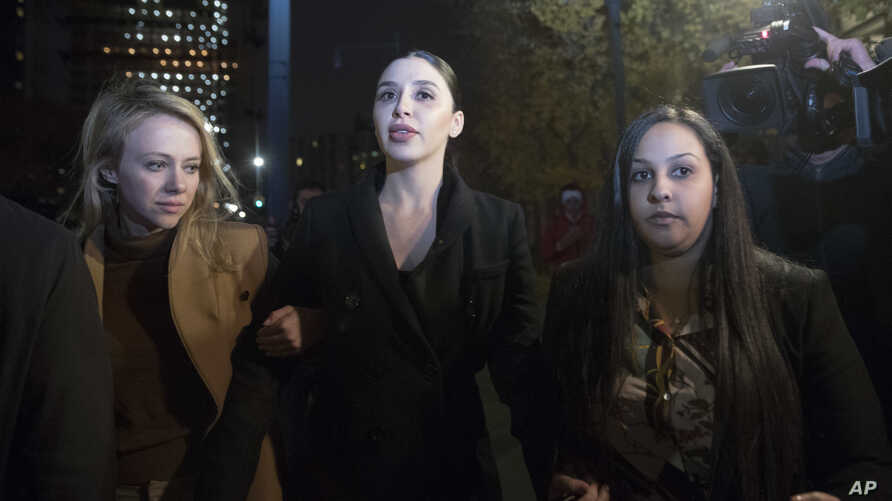 """Emma Coronel, center, the wife of Joaquin Guzman, leaves Brooklyn Federal Court after opening arguments in the trial of the Mexican drug lord known as """"El Chapo,"""" Nov. 13, 2018, in New York."""