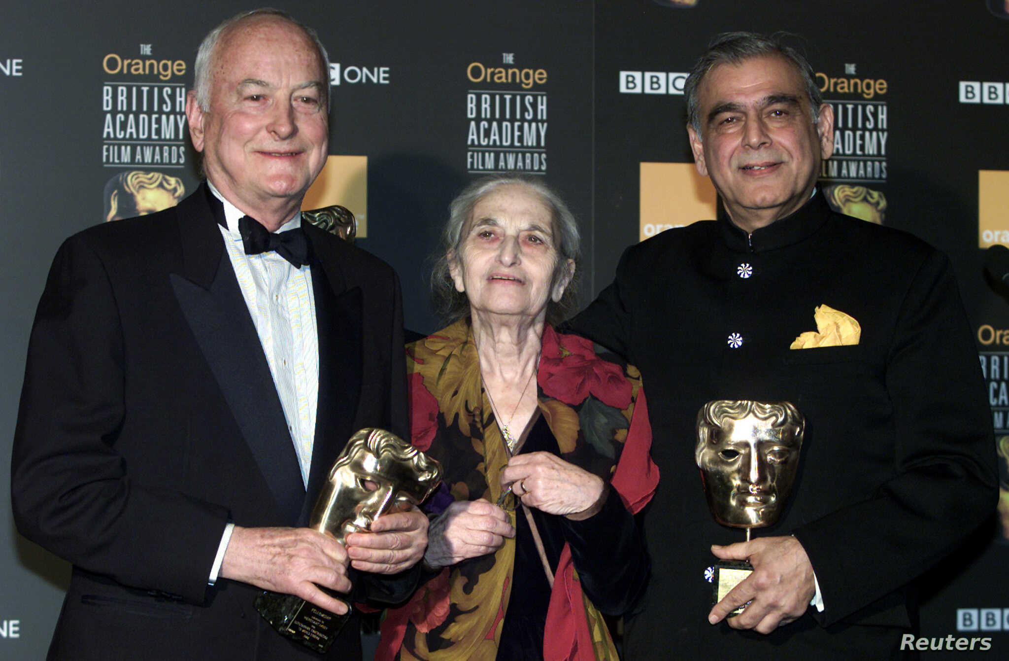 (L-R) James Ivory, Ruth Prawer Jhabvala and Ismail Merchant, who together form Merchant Ivory Productions, receive a British Academy film fellowship at a ceremony in central London, February 24, 2002.