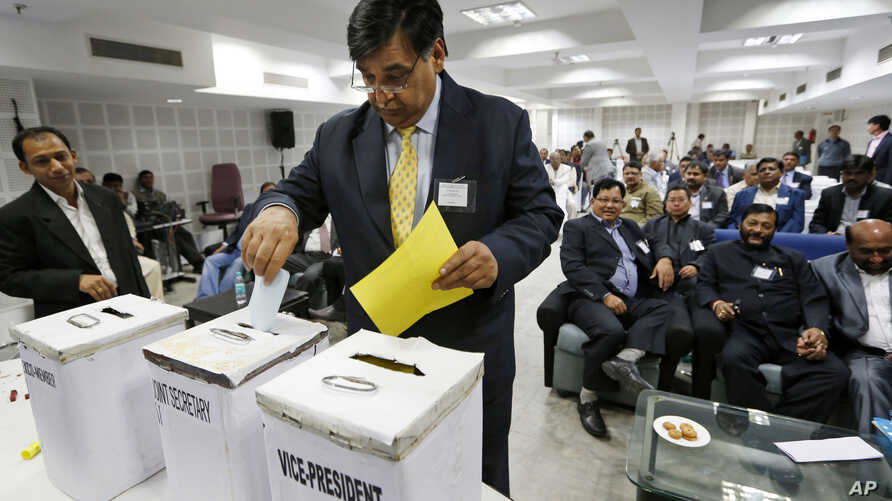 Lalit Bhanot, who was recently elected as the secretary general of the Indian Olympic Association (IOA), casts his ballot for the election of Vice President, Joint Secretary and Executive Council members of IOA in New Delhi, India, December 5, 2012.