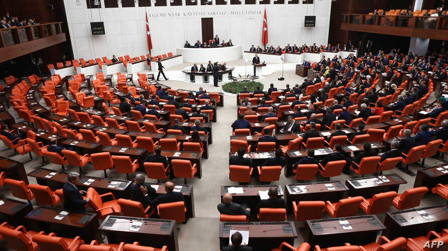 Turkish MPs and ministers attend a debate as the parliament reconvenes after a summer recess in Ankara, Oct. 1, 2015.