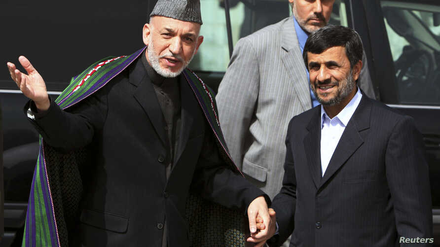 Afghan President Hamid Karzai (L) welcomes his Iranian counterpart Mahmoud Ahmadinejad upon his arrival in Kabul March 10, 2010.