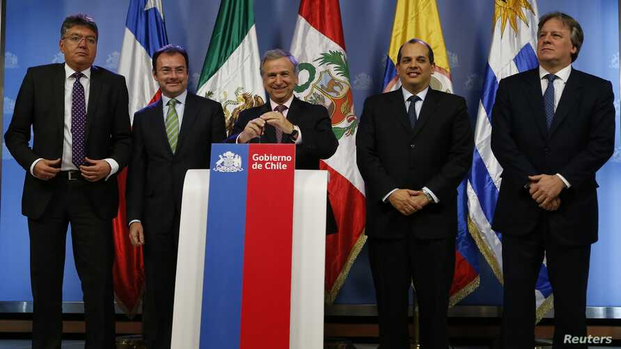 Chile's Finance Minister Felipe Larrain (C) prepares to speak while flanked by his regional counterparts during a news conference on the first meeting of the finance ministers of the Pacific Alliance in Santiago, Aug. 23, 2013.