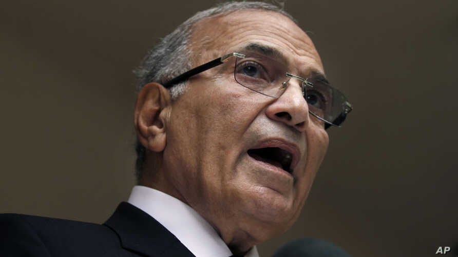 FILE - In this May 26, 2012, photo, Egyptian presidential candidate Ahmed Shafiq speaks to the media during a press conference at his office in Cairo, Egypt.
