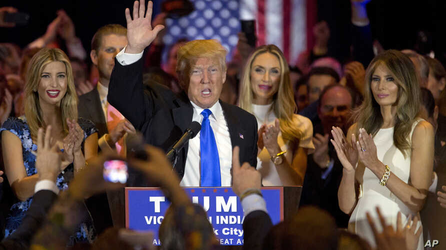 Republican presidential candidate Donald Trump is joined by his wife Melania, right, daughter Ivanka, left, as he speaks during a primary night news conference, Tuesday, May 3, 2016.