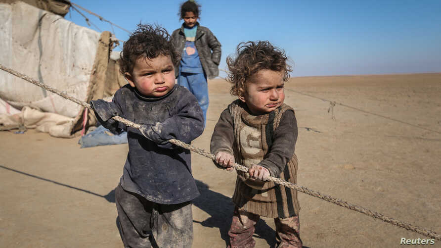 Internally displaced Syrian children who fled Raqqa city stand near their tent in Ras al-Ain province, Syria January 22, 2017.