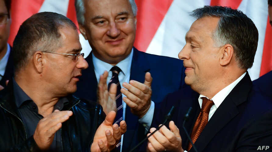 Hungarian Prime Minister Viktor Orban (R) celebrates with his party leader of their governing FIDESZ party, vice-president Lajos Kosa (L) and deputy prime minister Zsolt Semjén of the Christian Democratic People's Party in 'Balna' cultural center of