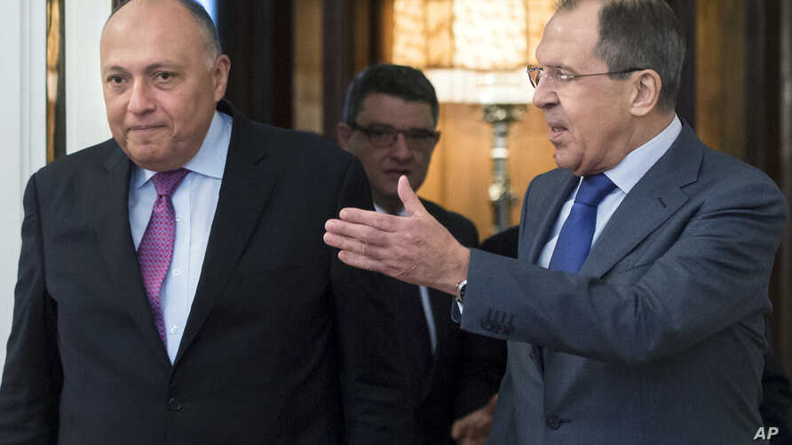Russian Foreign Minister Sergey Lavrov, right, and his Egyptian counterpart Sameh Shukry arrive for their meeting in Moscow, Russia, Wednesday, March 16, 2016.