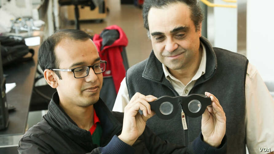 "University of Utah electrical and computer engineering professor Carlos Mastrangelo, right, and doctoral student Nazmul Hasan have created ""smart glasses"" with liquid-based lenses that can automatically adjust the focus on what a person is seeing, wh"