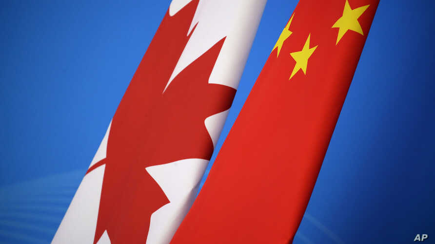 FILE - Flags of Canada and China are placed for the first China-Canada economic and financial strategy dialogue in Beijing, Nov. 12, 2018.