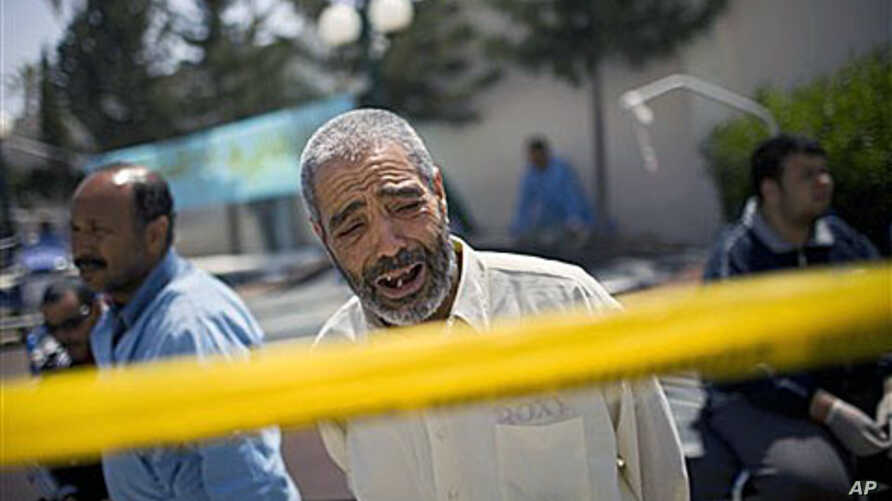 A Libyan man weeping outside Hikma hospital in Misrata, Libya. The port of a besieged rebel-held city in western Libya was quiet Wednesday after fierce bombardment and attack the day before by government forces. It is unknown why the man is weeping,