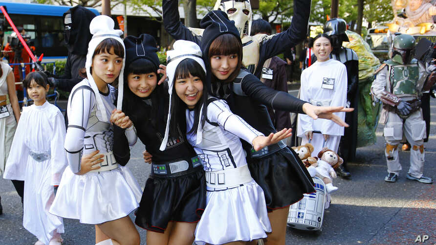 Star Wars fans dressed in costumes of Star Wars characters pose for a photo during a Halloween parade in Kawasaki, near Tokyo, October 25, 2015.