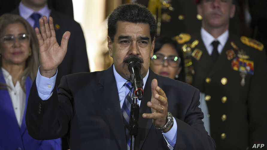 FILE - Venezuelan President Nicolas Maduro speaks at Miraflores Presidential Palace in Caracas, June 21, 2019. The U.S. Treasury Department on June 27, 2019, indicted two former officials in Maduro's government on money laundering and corruption charges.