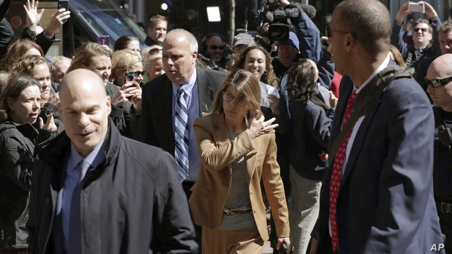 FILE - Fans photograph actress Lori Loughlin as she arrives at federal court in Boston, Massachusetts, April 3, 2019, to face charges in a nationwide college admissions bribery scandal.