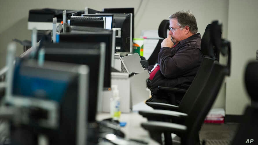 FILE - A workers sits a computer at the Department of Homeland Security's National Cybersecurity and Communications Integration Center (NCCIC) in Arlington, Va., Aug. 22, 2018.
