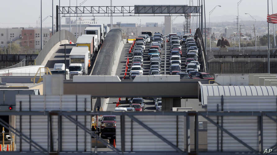 FILE - In this March 29, 2019, photo, cars and trucks line up to enter the U.S. from Mexico at a border crossing in El Paso, Texas. A 2½-year-old Guatemalan child has died after crossing the border, becoming the fourth minor known to have died after...