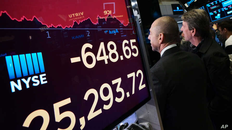 An electronic screen shows the drop in the Dow Industrials, May 13, 2019 at the New York Stock Exchange.