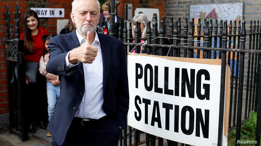 Britain's Labour Party leader JeremyCorbyn gestures after voting at a local polling station in his constituency in London, May 23, 2019.