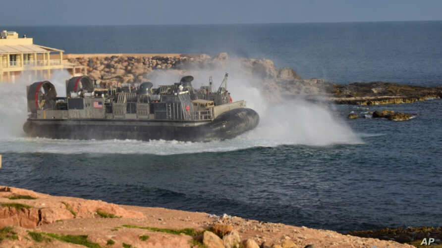 A U.S. amphibious hovercraft departs with evacuees from Janzur, west of Tripoli, Libya, Sunday, April 7, 2019. The United States says it has temporarily withdrawn some of its forces from Libya due to deteriorating security conditions.