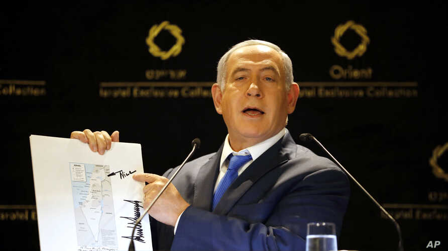 Israeli Prime Minister Benjamin Netanyahu shows a map from U.S. President Donald Trump's son-in-law Jared Kushner during statements to the press in Jerusalem, May 30, 2019.