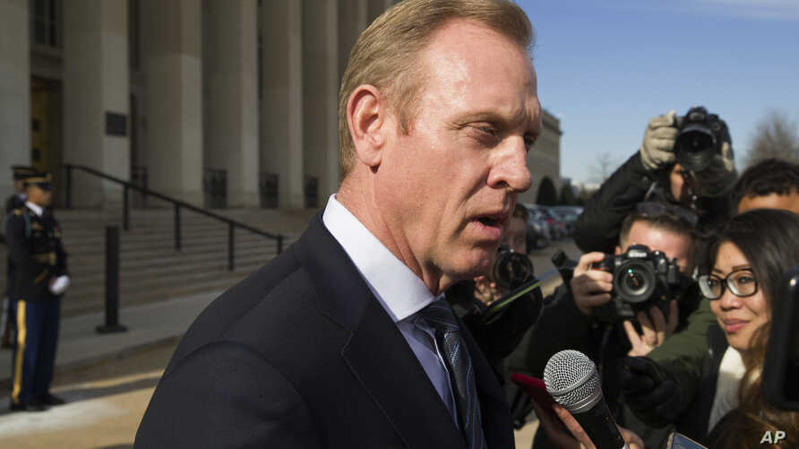 FILE - In this Jan. 28, 2019, file photo, acting Defense Secretary Pat Shanahan speaks with the media as he waits for the arrival of NATO Secretary General Jens Stoltenberg at the Pentagon in Washington.