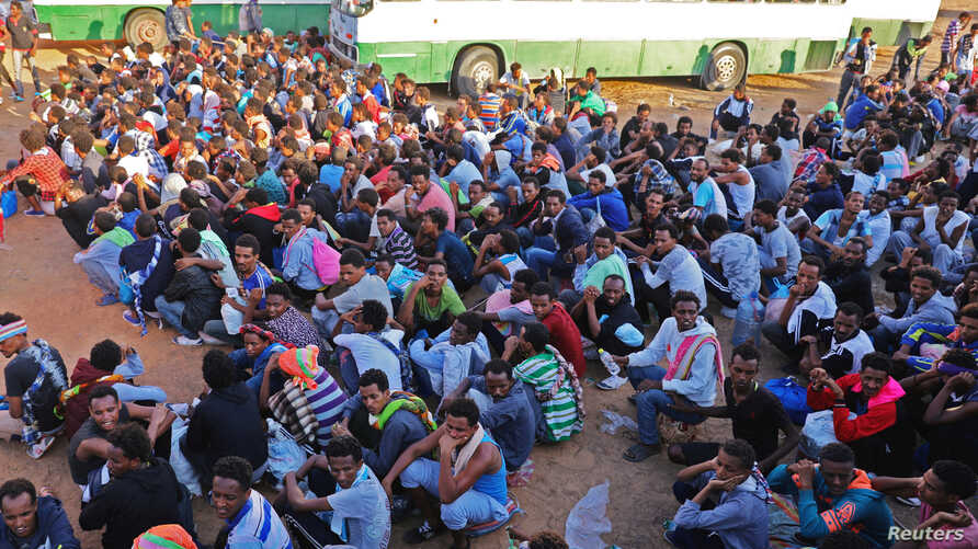 Migrants are seen after they were relocated from government-run detention centres,