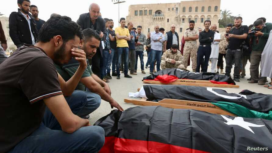 Mourners gather for funeral prayers for fighters killed by warplanes of Field Marshal Khalifa Hifter's forces,  April 24, 2019 in Tripoli, Libya.
