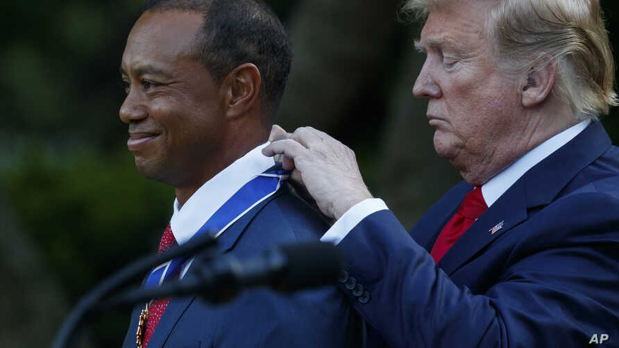 President Donald Trump presents golfer Tiger Woods with the Presidential Medal of Freedom, in the Rose Garden of the White House, May 6, 2019, in Washington.
