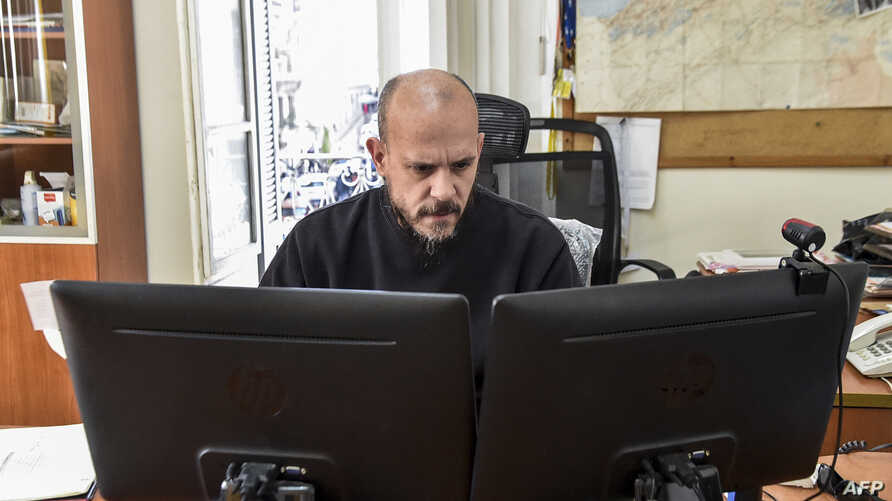 FILE - Aymeric Vincenot, AFP's Algiers bureau chief, sits at his office in the capital Algiers, March 1, 2019.