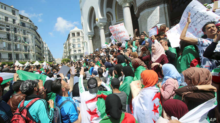 Students take part in a protest seeking the departure of the ruling elite in Algiers, Algeria April 16, 2019.
