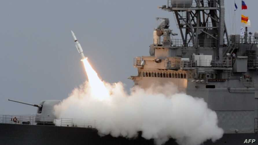 FILE - A Taiwan navy Kidd-class destroyer launches an SM-2 surface-to-air missile during a drill at sea near the east coast of Taiwan, Sept. 26, 2013. The Pentagon announced May 17, 2019, that a possible sale of $314 million worth of the missiles to ...