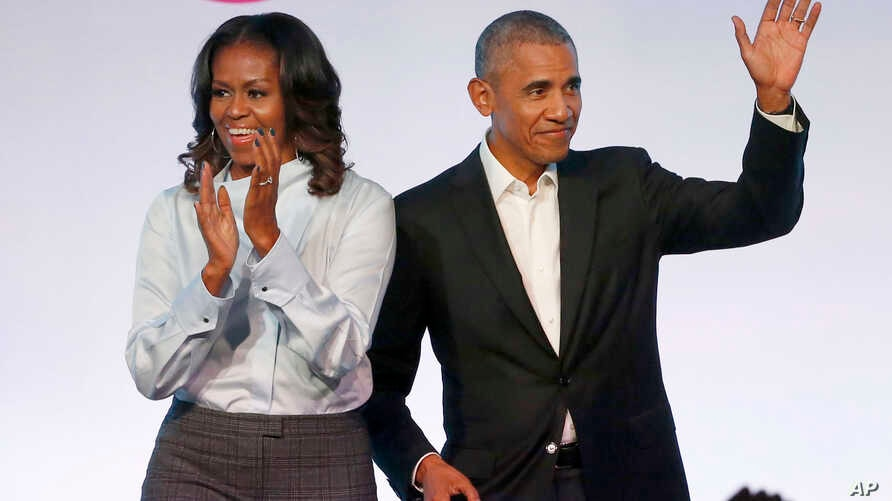 FILE - Former President Barack Obama, right, and former first lady Michelle Obama appear at the Obama Foundation Summit in Chicago, Oct. 31, 2017.