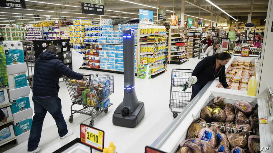 FILE- A robot named Marty cleans the floors at a Giant grocery store in Harrisburg, Pa., Jan. 15, 2019.