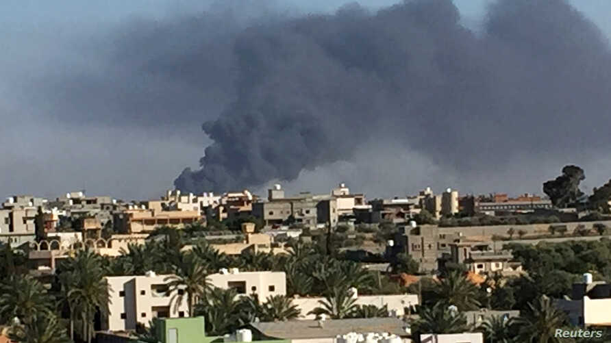 Smoke rises during a fight between members of the Libyan internationally recognized government forces and Eastern forces in Ain Zara, Tripoli, Libya, May 5, 2019.