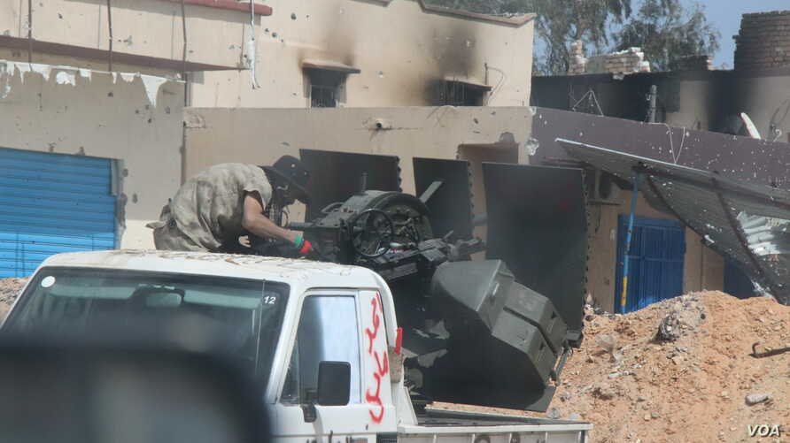While neither side appears to be gaining ground, fighters from Eastern Libya battle daily with Western forces in Tripoli, Libya, May 1, 2019.