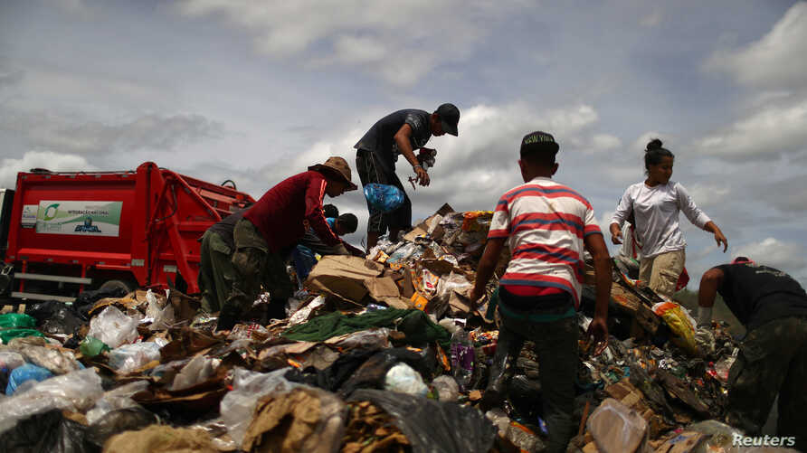 Venezuela migrants are seen at a garbage dump in the border city of Pacaraima, Brazil, April 15, 2019.