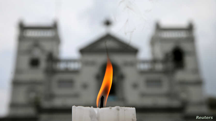 A candle burns outside St. Anthony's Shrine a week after a string of suicide bomb attacks across the island on Easter, in Colombo, Sri Lanka, April 28, 2019.