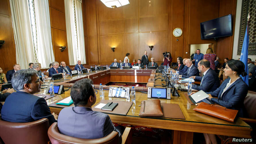 Iran's Deputy Foreign Minister Hossein Jaberi Ansari, Russia's special envoy on Syria Alexander Lavrentiev, Turkish Deputy Foreign Minister Sedat Onal, and U.N. Special Envoy for Syria Staffan de Mistura attend a meeting during consultations on Syria...