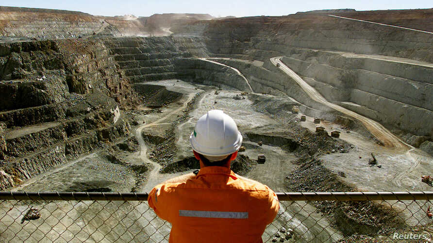 FILE - A miner looks across the largest open pit gold mine in Australia called the Fimiston Open Pit, also known as the Super Pit, in the gold-mining town of Kalgoorlie, located around 500 kilometres east of Perth, July 27, 2001.