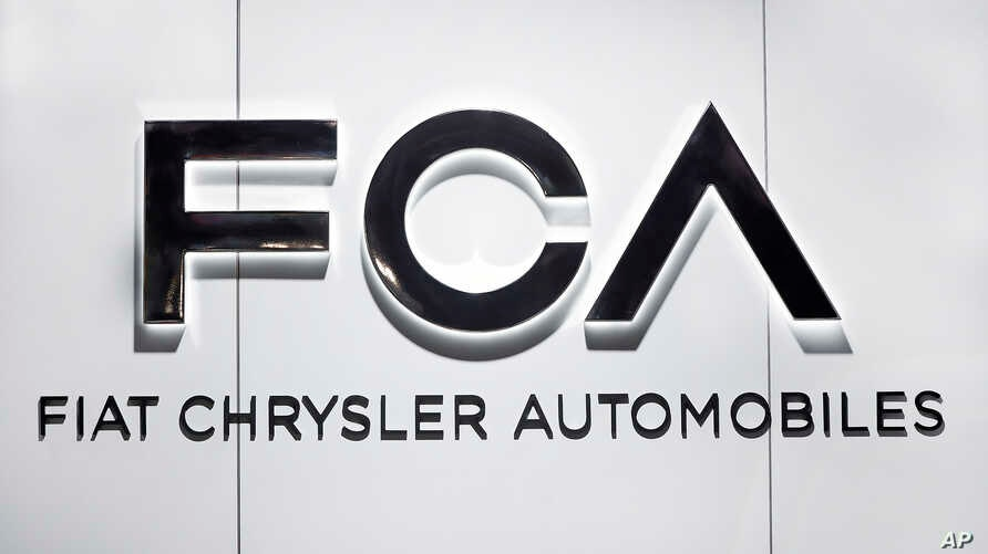 FILE - Fiat Chrysler Automobiles FCA logo is shown at the North American International Auto Show in Detroit, Michigan, Jan. 14, 2019.