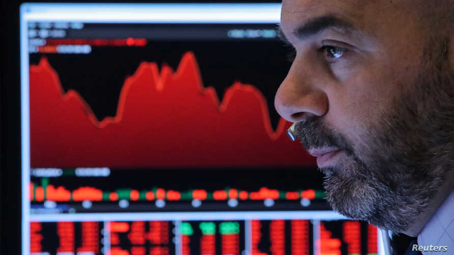 A Trader works at his station on the floor at the New York Stock Exchange (NYSE) in New York, US, May 13, 2019.