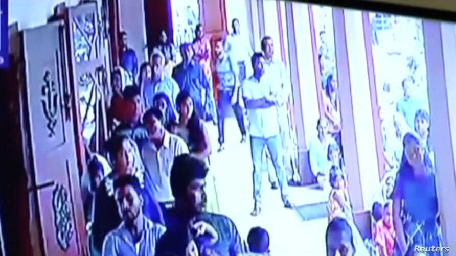 A suspected suicide bomber enters St Sebastian's Church in Negombo, Sri Lanka April 21, 2019 in this still image taken from a CCTV handout footage of Easter Sunday attacks released on Apr. 23, 2019. (CCTV/Siyatha News via Reuters)