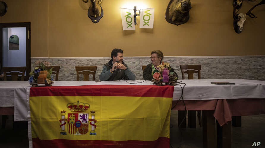 Vox's Ciudad Real provincial candidate Ricardo Chamorro, left, and Toyan Patón during a meeting with local farmers at a bar in Brazatortas, on the edge of the Alcudia valley, central Spainو April 10, 2019.