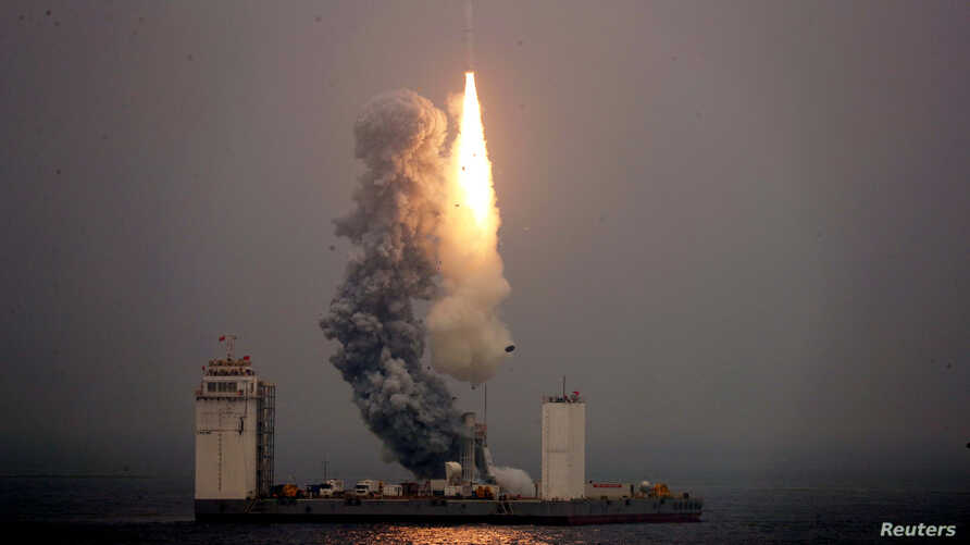 A Long March 11 carrier rocket takes off from a mobile launch platform in the Yellow Sea off Shandong province, China, June 5, 2019.