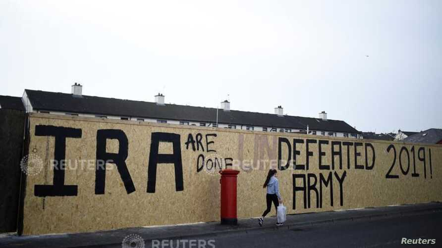 IRA graffiti painted over with a message declaring it a defeated army is pictured in Londonderry, Northern Ireland, Apr. 19, 2019.