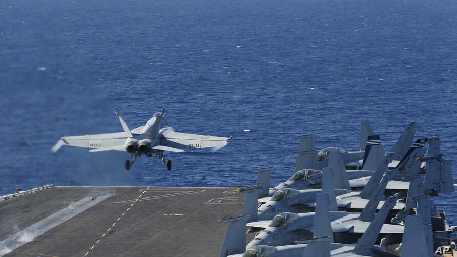 In this May 3, 2019 photo released by the U.S. Navy, An F/A-18E Super Hornet from VFA 25 launches from the flight deck of the Nimitz-class aircraft carrier USS Abraham Lincoln.
