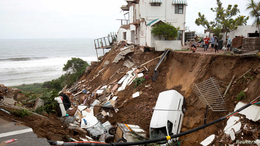 Vehicles and debris are scattered after massive flooding in Amanzimtoti, near Durban, South Africa, April 24, 2019.